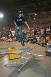 Dustin Kelm jumping off of unicycle